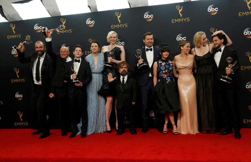 """The cast of HBO's """"Game of Thrones"""" pose backstage with their awardS at the 68th Primetime Emmy Awards in Los Angeles, California"""